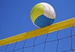 Volleyball going over net